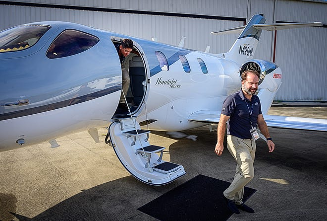 Volato director of operations Jim Lawson and Matt Liotta, co-founder and CEO of the company, exit oneof their HondaJet Elite corporate jets at the Northeast Florida Regional Airport on Friday, Sept. 17, 2021.