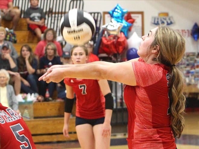 BNL senior Maddy Bennett comes up with a one of her team-high 11 digs as fellow senior Carlee Kern (7) closes in during the Stars' Senior Night sweep of Shoals.