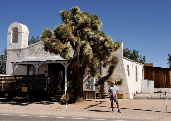 """John stands outside the Sanctuary Adventist Church east of Lancaster. Film director Quentin Tarantino used the church to film scenes for his """"Kill Bill"""" movies."""