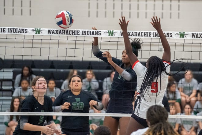 Waxahachie's Tionna Owens (right) goes up for a kill while teammates Hannah Morgan (5) and Emma Borders (20) look on during last Friday's home match against Waco High.