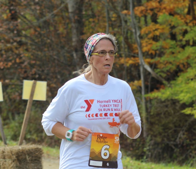 Kim Schmitt of Hornell nears the finish line in the 2019 RidgeWalk and Run. The 2021 event will be virtual due to rising COVID-19 cases in the area.