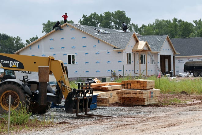 Contractors build a house on Honor Street in Neenah. The city and the town of Neenah have had a boundary agreement in place since 2003 that defines areas of development in the two communities.