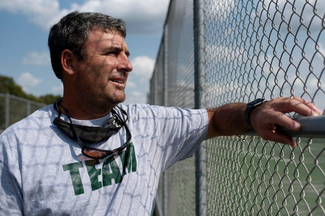 Pennfield tennis coach John Corcoran stands for a portrait on Tuesday, Sept. 14, 2021 at Pennfield High School.