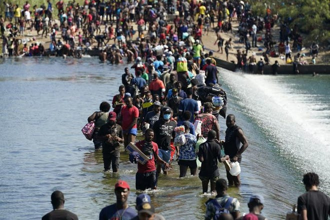Haitian migrants use a dam to cross to and from Mexico and Del Rio, Texas, on Sept. 17.