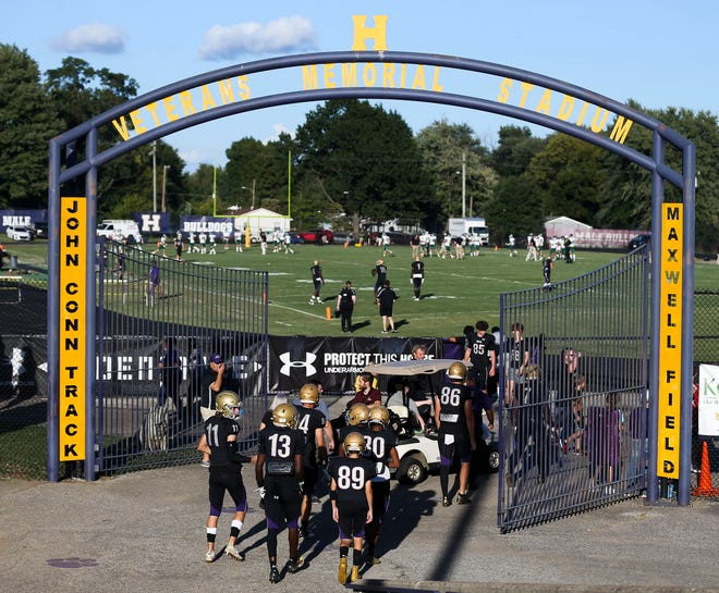 Male players walk to the field for pregame warmup against Trinity Friday. Sept. 18, 2021