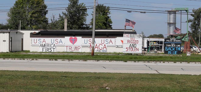 A group of signs which have been subjects of concern along Maritime Drive as seen, Friday, September 17, 2021, in Manitowoc, Wis. Some of the signs have swear words and have upset the community according to reported complaints.
