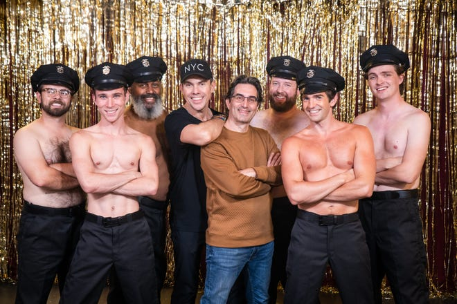 """Skylight Music Theatre artistic director Michael Unger (center, brown shirt) poses with director James Gray (black shirt) and cast members of """"The Full Monty."""""""