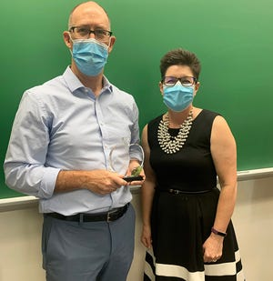 Thomas Arnold, a history teacher for the Indiana Academy of Science, Mathematics and Humanities, was awarded the 2021 Robert P. Bell Creative Teaching Award. He was presented with the award by Community Foundation President Kelly K. Shrock.