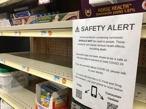 A warning sign about human use of the veterinary version of Ivermectin, typically used as a horse dewormer, is posted on a shelf at this tractor supply store.