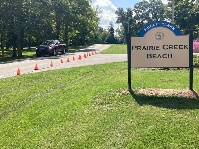 A pickup truck glides past the beach entrance at Prairie Creek Lake Friday afternoon. The site on Delaware County Road 560 East is pegged as one of three locations on the road being considered for stop signs designed to slow traffic at the reservoir, which some residents say is dangerously fast and often far above the the post 30 mph limit.