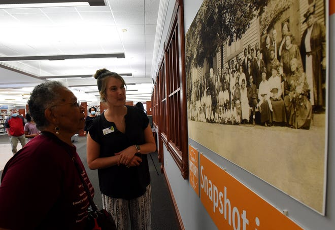 Rebecca Black, who found the photo from 1920 the now hangs in the Licking County Library shows the photo to new library director Susanne SacchettiÊduring an unveiling on Thursday, Sept. 16, 2021. Black's grandmother, Esther Louise White, is one of many shown in the photo.
