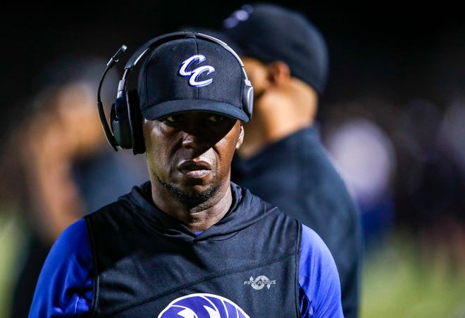 Cathedral City head coach Richard Lee walks up the sideline while watching his players during the third quarter of their game at Cathedral City High School, Thursday, Sept. 16, 2021, in Cathedral City.