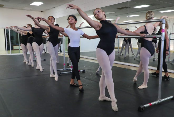 Dance students practice on the barre on Sept. 15, 2021, at the Palm Springs Dance Academy.