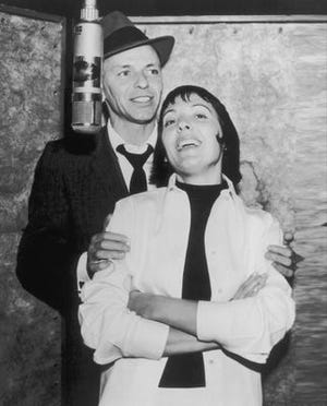 Keely Smith joins Frank Sinatra in a recording studio.