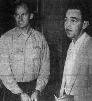 The image is from 1957 shortly after noon on the day he turned himself in. Jailer Marvin Noteboom is on the right.