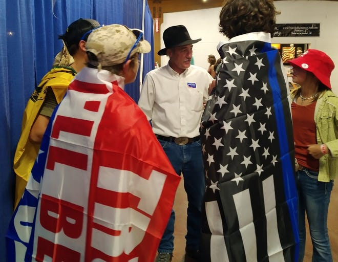 U.S. Senate candidate Mark Mowry speaks with attendees at the South Dakota State Fair in Huron earlier this month.