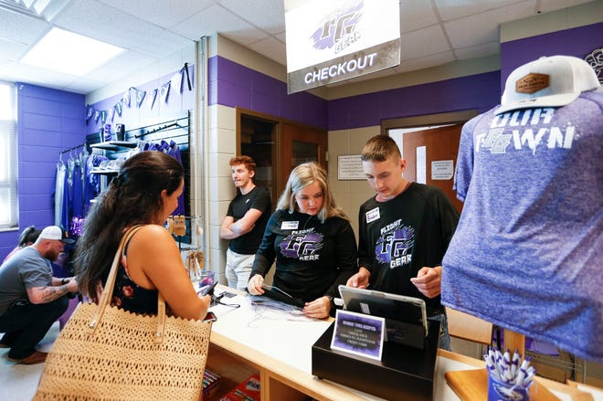 Fair Grove High School students Mckenzie Chandler and Braden Booth check out Martha Broughton for the new school store at Fair Grove High School on Tuesday, Sept. 14, 2021.