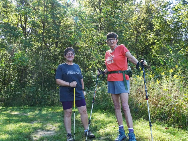 Debbie Lovensheimer and Mary Anne Sheffield hike at Dillon State Park on Thursday, Sept. 16, 2021. It was the second outing for the Zanesville-area cancer support group Stepping Stones, founded by Lovensheimer.