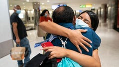 """Sep 16, 2021; Baltimore, MD, United States; Carlos and his daughter, Anyeli, are reunited at Baltimore/Washington International Thurgood Marshall Airport on Sept. 16, 2021, after spending three years apart. The father and daughter, originally from Guatemala, were separated at the U.S.-Mexico border under former President Donald Trump's """"zero-tolerance"""" policy. Hundreds of children may still be separated from that policy. Mandatory Credit: Jack Gruber-USA TODAY ORG XMIT: USAT-461755 [Via MerlinFTP Drop]"""