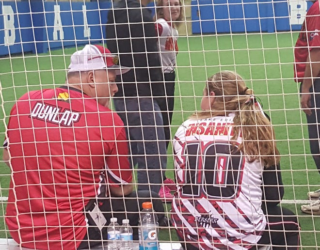 Louise Dunlop coached daughter Camille's softball team for eight years.