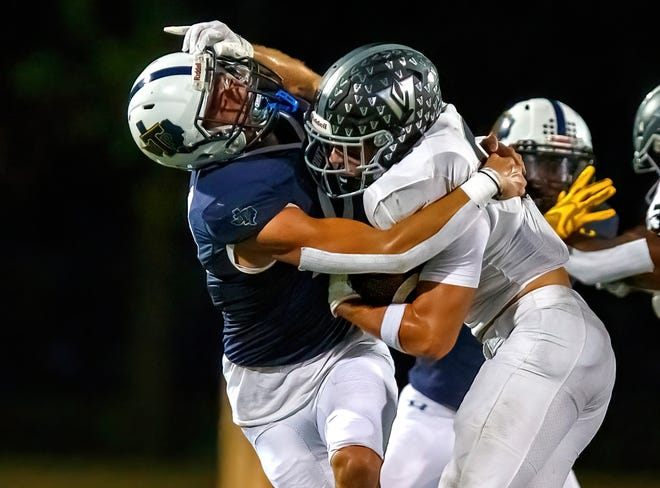 Stony Point's Lukas Morin, left, brings down Vandegrift Vipers running back William Sheppard during the third quarter of the District 25-6A game on Friday at Kelly Reeves Athletic Complex. Vandegrift used a fast start to roll to a 56-21 win in the district opener for both teams.