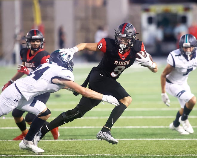 Reece Heffelfinger makes the catch for Vista Ridge and dodges McNeil Mavericks defenders in the district opener for both teams Sept. 17 at Gupton Stadium. Vista Ridge won its homecoming game 23-14 over McNeil.