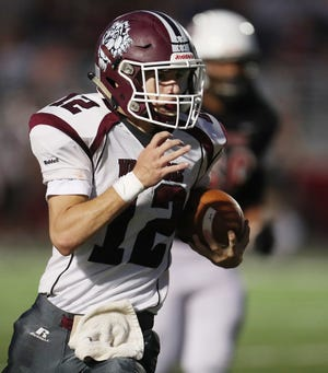 Woodridge quarterback David Hitchings runs for a gain during their game against Norton at Norton High School on Friday, Sept. 17, 2021, in Norton.