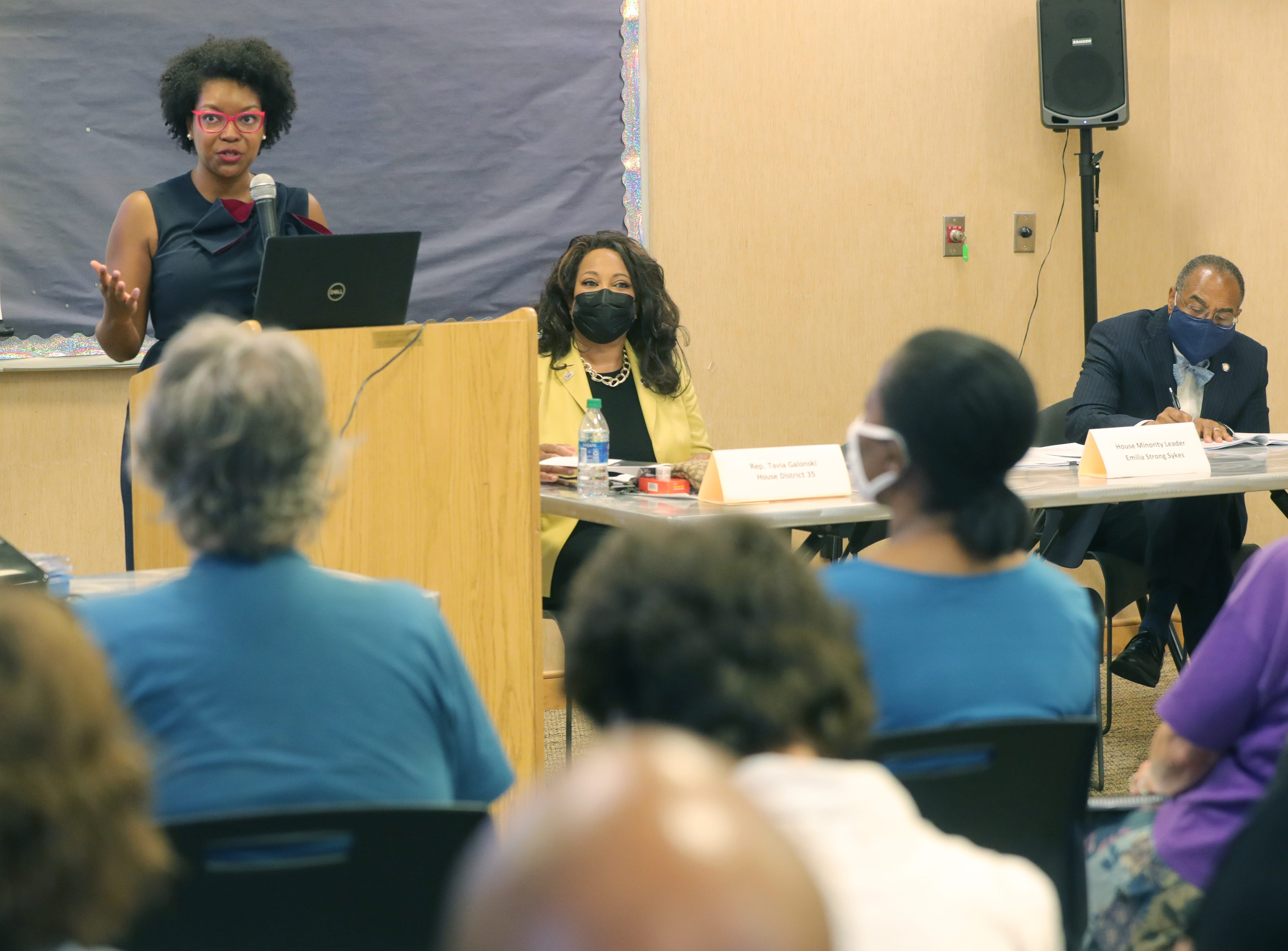 Ohio House Minority Leader Emilia Sykes, left, hosts a town hall with state Rep. Tavia Galonski, and Sykes' father, state Sen. Vernon Sykes, on Aug. 23 at the Maple Valley Library in Akron.
