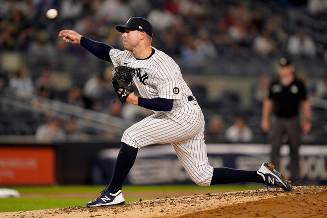 New York Yankees starting pitcher Corey Kluber throws during the third inning of the team's baseball game against the Cleveland, Friday, Sept. 17, 2021, in New York. (AP Photo/John Minchillo)