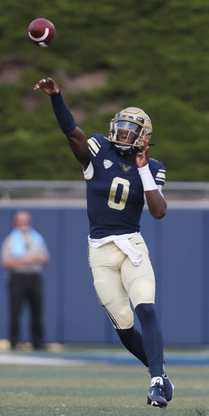 University of Akron quarterback DJ Irons passes against visiting Bryant in the first half of the Zips' 35-14 win Saturday at InfoCision Stadium. [Mike Cardew/Beacon Journal]