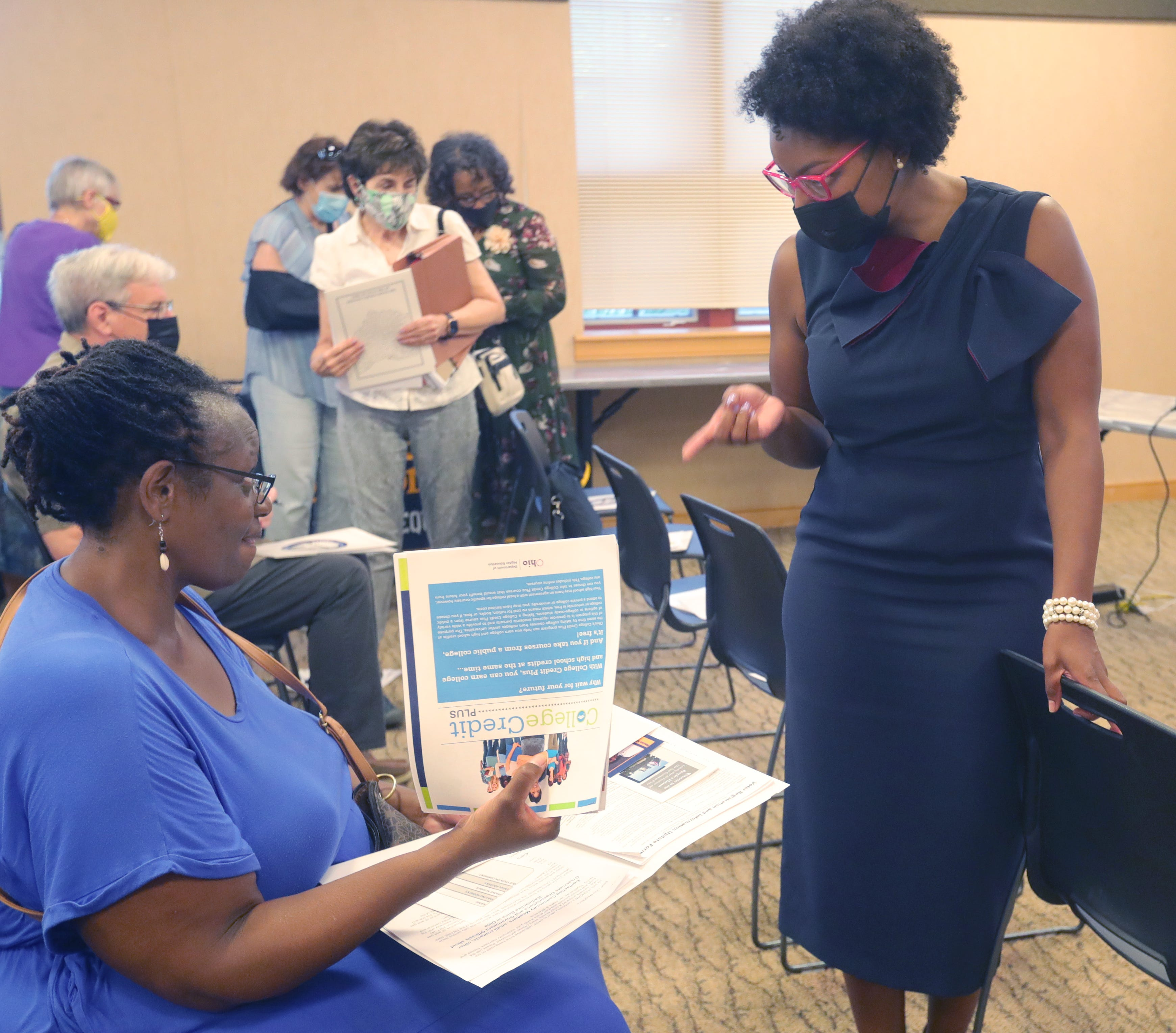 Emilia Sykes, right, talks with Tonya King before a town hall meeting Aug. 23 at the Maple Valley Library in Akron.