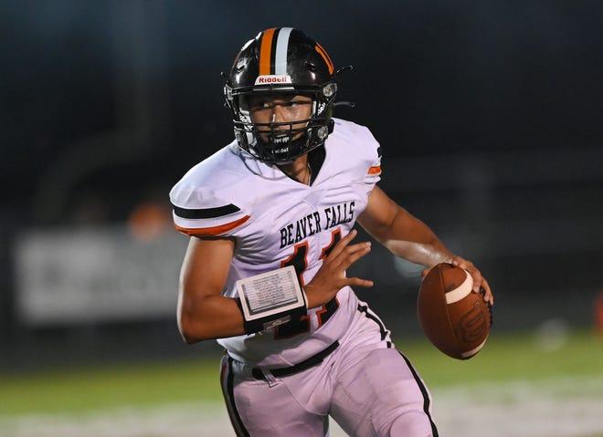 Beaver Falls' quarterback Jaren Brickner looks for a receiver during a game at Laurel High School.
