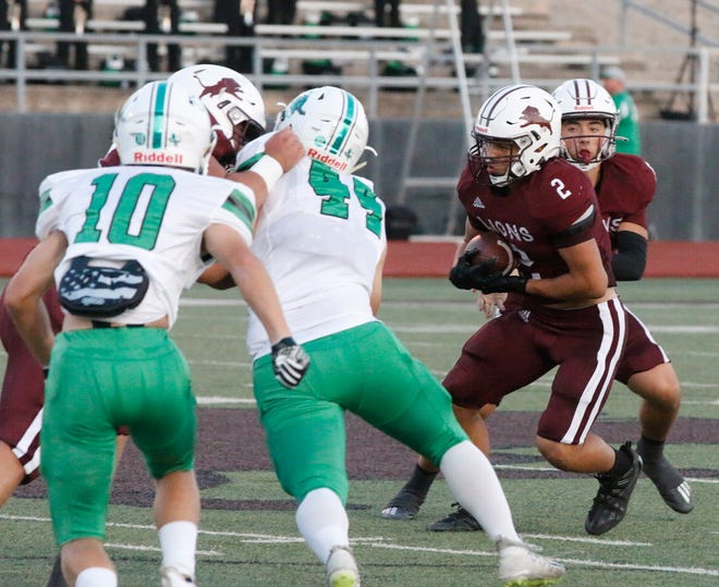 Brownwood running back Konlyn Anderson (2) churned out 261 yards rushing and two touchdowns on 33 carries in the Lions' 31-26 win over Burnet on Friday at Gordon Wood Stadium in Brownwood.