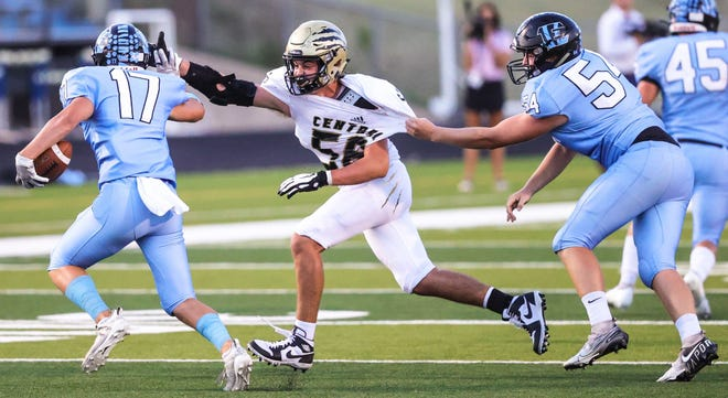 Andover Central's Dawson Howard (56) fights through a hold in the 35-13 win over Goddard Eisenhower on Friday at Goddard Stadium.