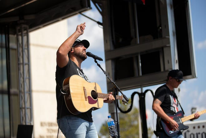 Former Ohio State lineman Evan Blankenship sings with his band North to Nashville at a tailgate outside Ohio Stadium in Columbus on Sept. 18.