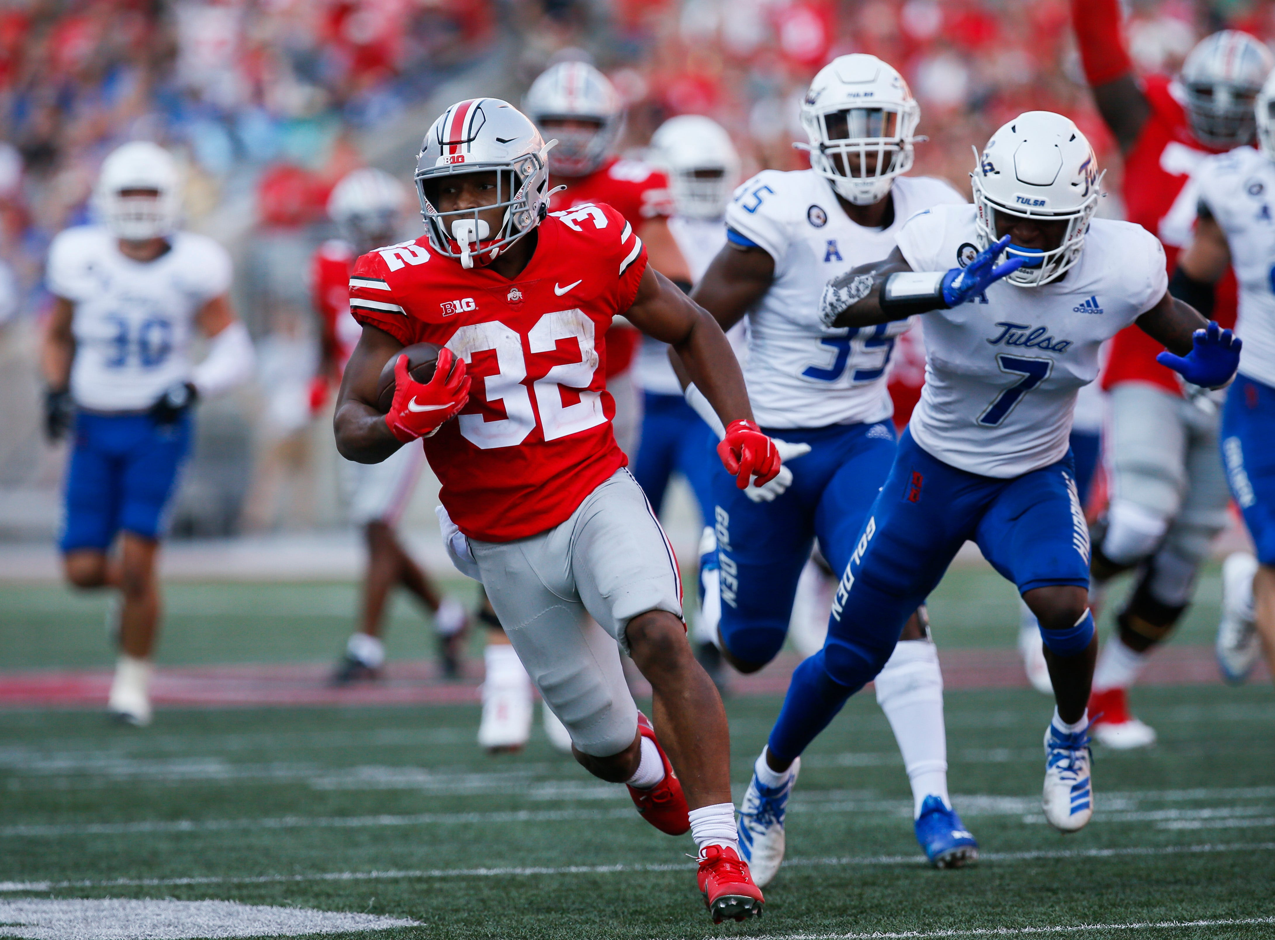 Ohio State Buckeyes running back TreVeyon Henderson (32) runs the ball for a touchdown during the third quarter of a NCAA Division I football game between the Ohio State Buckeyes and the Tulsa Golden Hurricane on Saturday, Sept. 18, 2021 at Ohio Stadium in Columbus, Ohio.