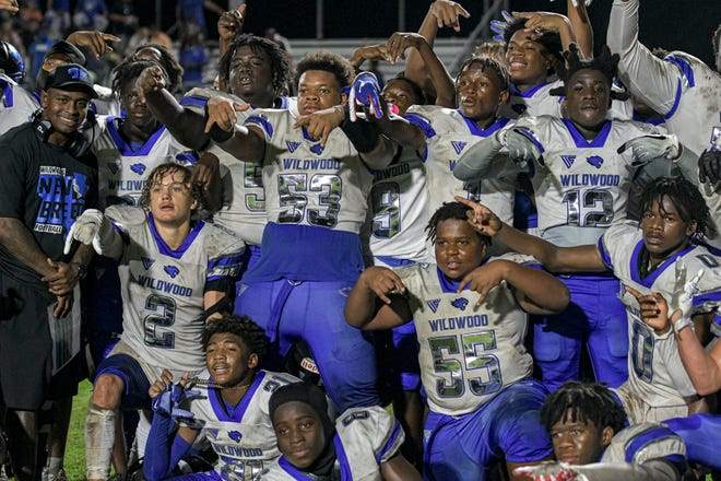 The Wildwood football team celebrates after beating South Sumter 20-9 Friday in Bushnell. [PAUL RYAN / CORRESPONDENT]