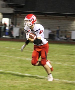 Hornell's Griffyn Baker returns a kickoff during Friday's contest in LeRoy.