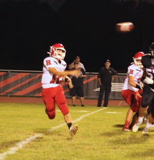 Hornell's Dom Nasca fires a pass toward the sideline during Friday's game against LeRoy.