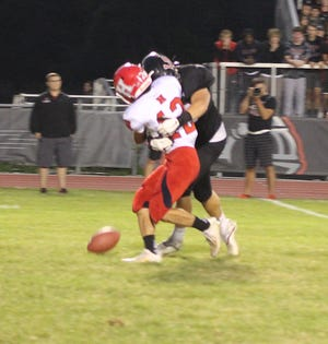 Hornell's Dom Nasca is taken down by a LeRoy defender as the fumble falls to the ground during Friday's game.