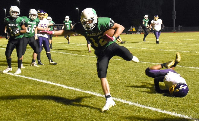 Herkimer Magician Jacob Huyck (12) crosses the goal line after catching a screen pass from Nick Caruso during the third quarter Friday against Waterville/Hamilton.