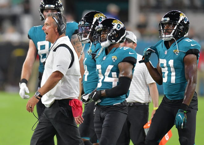 Jaguars head coach Urban Meyer tries to get his players' attention in a preseason game against Cleveland.