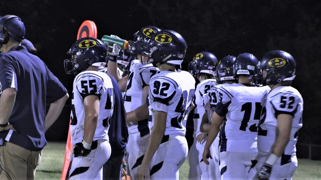 Hillsdale's sideline watches the offense in second half game action against the Hudson Tigers.