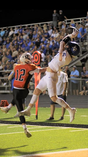 Gunter's Cannon Lemberg catches a touchdown pass over Pilot Point's Crew Chandler in non-district action.