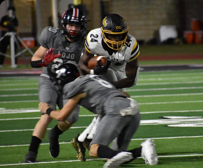 Denison's Jadarian Price looks for running room that was hard to come by in the Yellow Jackets' district loss to Lovejoy.