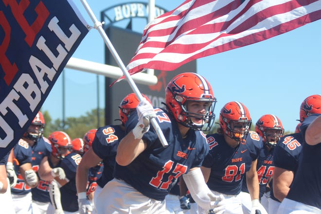 Hope junior WR Ryder Smith runs out onto the field before the Flying Dutchmen's win over Rose-Hulman