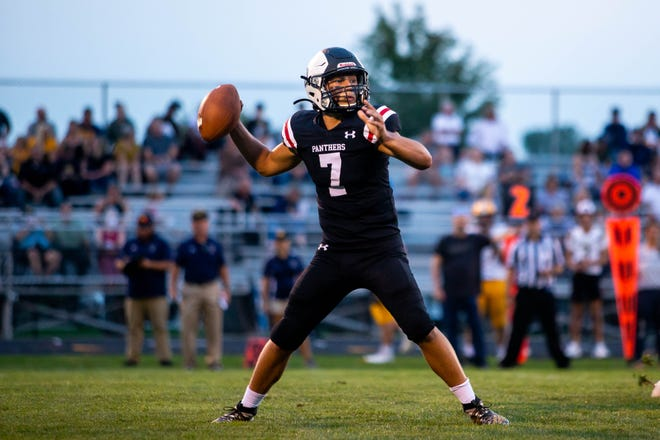 West Ottawa's Cole Tulgestke looks downfield to throw during the second quarter against Grand Haven Friday, Sept. 17, 2021 at West Ottawa's Panthers Stadium.