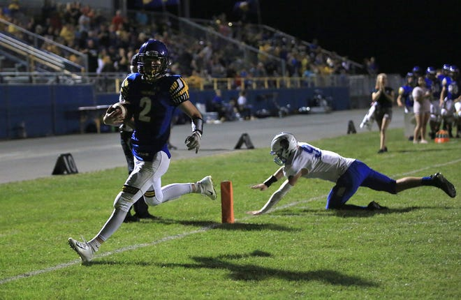 Nickerson's Colton Morrell (2) scores a touchdown past Lyons' Cade Crawford (9) during their game Friday night, Sept. 17, 2021, in Nickerson. Lyons defeated Nickerson 28-26.