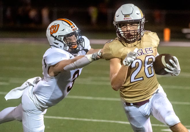 Dunlap ballcarrier Graham Glover eludes a defender during a game earlier this season against Washington. The junior had a big game on offense and defense to help Dunlap beat Limestone, 39-0.