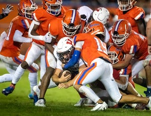 Bartow defenders tackle Victory Christian's Isaiah Reynolds during action in September. If the season ended now, Bartow would be in the playoffs, and Victory Christian would be out.